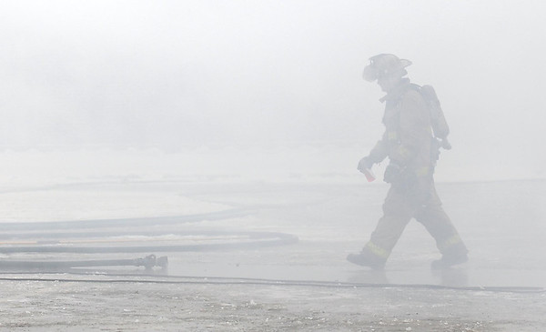 Pat Christman<br /> A firefighter is shrouded in smoke from Saturday's practice burn.