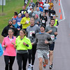 Pat Christman<br /> Half marathoners run down County Road 90 Sunday.
