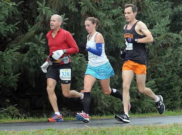 Pat Christman<br /> A trio of marathon runners run together during Sunday's race.