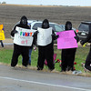 Pat Christman<br /> A trio of monkeys and a banana cheer on a marathon runner Sunday.