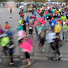 Pat Christman<br /> Runners stream around a corner at the start of the Mankato Marathon Sunday.