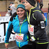 Pat Christman<br /> Courtland's Emily Schmitt, left, and Kelli Buegler of New Ulm embrace after finishing the half marathon Sunday.