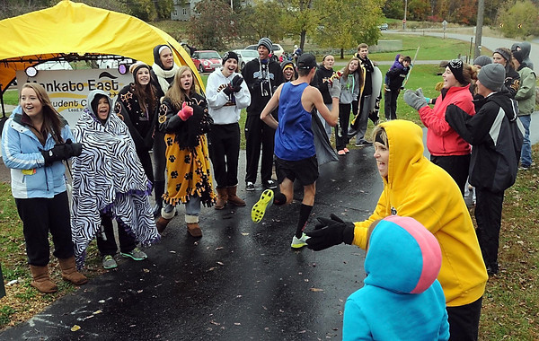 Pat Christman<br /> Members of the Mankato East student council cheer on a marathon runner near Mount Kato Sunday.