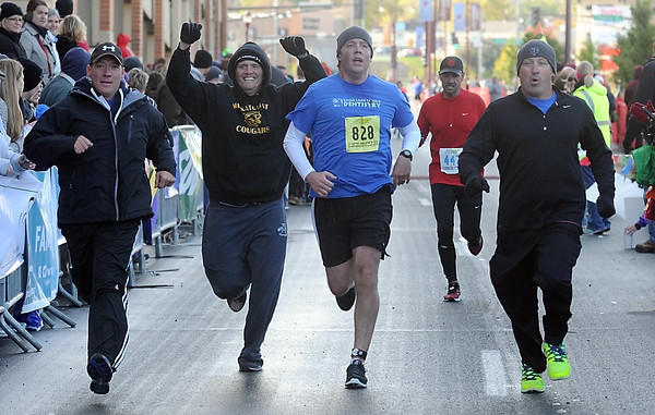 Pat Christman<br /> A marathon relay team called the Quad Lakers Beer Drinkers, made up of Greg Oachs, Mike McDonald, Sean Vostad and Brent Atherton, cross the finish line together Sunday.