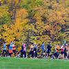 Pat Christman<br /> Runners are surrounded by fall color as they run down a hill Sunday.