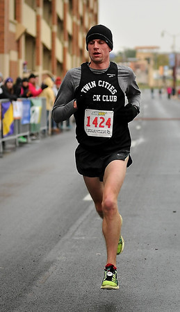 John Cross<br /> Chris Erichsen of Minneapolis was the first to cross the finish line of the half-marathon Sunday with a time of 1:09:53.