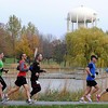 Pat Christman<br /> Runners in Sunday's marathon make their way through Lions Park.