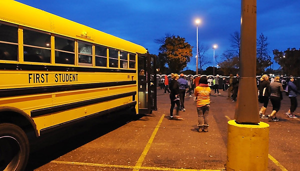 John Cross<br /> Runners were transported from downtown Mankato to the starting line at Minnesota State University prior to the Mankato Marathon on Sunday by fleets of school buses.