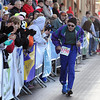 Pat Christman<br /> Burt Carlson, 88, finishes the half marathon Sunday to cheers from the crowd.