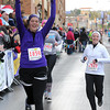 Pat Christman<br /> Whitney Kerr of Mankato celebrates as she crosses the finish line after completing the half marathon Sunday.