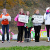 Pat Christman<br /> Girls cheer on a runner during Sunday's half marathon.
