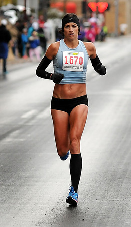 John Cross<br /> Mankato runner Lindsay Henkels was the second woman to cross the finish line in the half-marathon on Sunday with a time of 1:19:28.