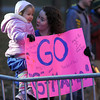 Pat Christman<br /> Addison Tate holds her cousin Mia Graff as they cheer the start of the 10K race Sunday.