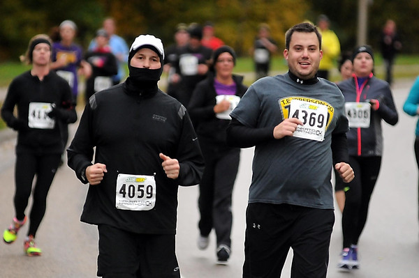 John Cross<br /> Conditions were cool and damp for runners in the 10K race on Sunday.