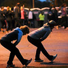 John Cross<br /> Runners performed some pre-race stretching exercises before running in the Mankato Marathon Sunday.