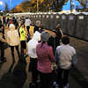 John Cross  <br /> Runners queue up in front of portable bathrooms prior to the running of the Mankato Marathon on Sunday.