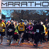 Pat Christman<br /> Runners leave the start line of the 10K race Sunday.