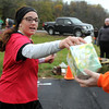 Pat Christman<br /> A runner takes a tissue from a volunteer during Sunday's half marathon.