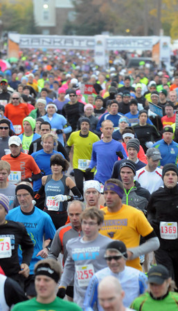 Pat Christman<br /> A sea of runners leave the start line of the Mankato Marathon and half marathon Sunday.