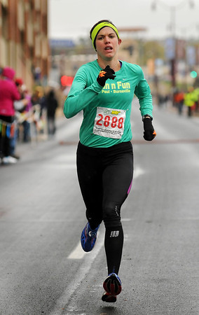 John Cross<br /> Elizabeth Yetzer of Lakeville was the first women to cross the finish line for the half-marathon on Sunday with a time of 1:18:24.