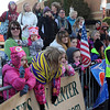 Pat Christman<br /> Fans cheer at the finish line of the Mankato Marathon Sunday.