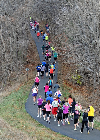 Runners head into the woods during Sunday's half marathon.