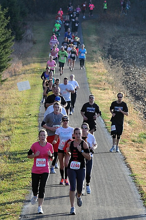 Half marathon runners emerge from the woods during Sunday's race.