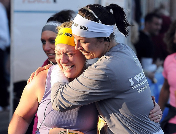John Cross<br /> Runners congratulate each other after successfully completed the Mankato Marathon 10K race.