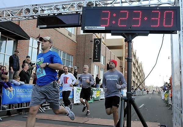 John Cross<br /> Finishers in the full marathon cross the finish line at the Verizon Wireless Center.