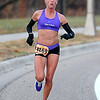 Mankato Marathon 10K Women's Division Winner Jen Blue runs along Stoltzman Road.