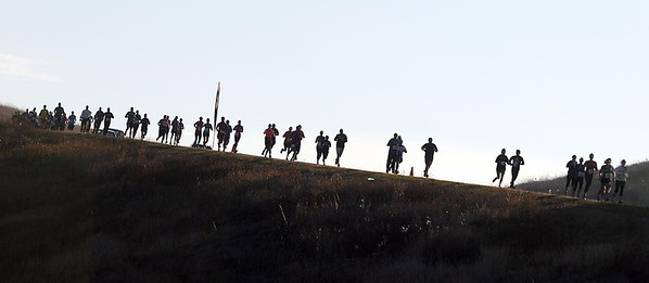 Half marathon runners head down a hill on County Road 90 during Sunday's race.