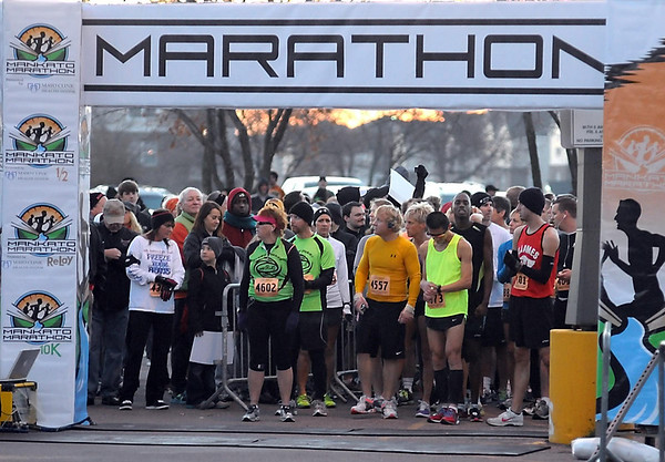 Runners wait under the start gate before Sunday's 10K race.