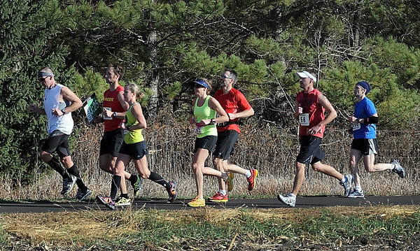 Marathoners run with a pace runner during Sunday's Mankato Marathon.