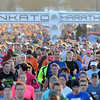 Runners leave from the start gate during Sunday's Mankato Marathon.