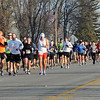 Half marathon runners make their way down Monks Avenue Sunday.