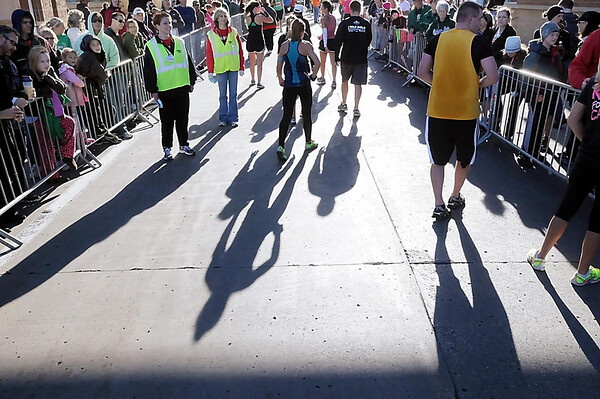 John Cross<br /> Runners head for post-race stations offering water, juices, fruit and other recovery foods after participating in Mankato Marathon events.