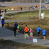 Half marathon runners move down the trail during Sunday's race.