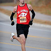 John Cross<br /> Mankato Marathon 10K Men's Division winner Bryan Christensen runs along Stoltzman Road.