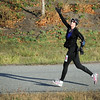 Beth Schmoll blows a kiss to friends during Sunday's half marathon.
