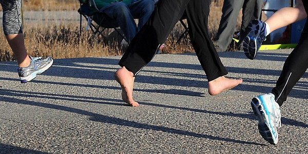 A runner opts to run without shoes during Sunday's half marathon.