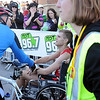 John Cross<br /> Mankato Marathon men's winner Paul Donnelly was wheeled away in a wheel chair by medical personnel after briefing collapsing after crossing the finish line.