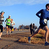 Marathon runners make the turn at County Road 90 during Sunday's race.