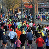 Runners make the turn onto Stadium Road during Sunday's Mankato Marathon.