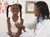 P6.1 / RWC Photo: doctor attending to a baby or school-age child.<br /> Choice 3 of 9