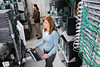 P7.1 RWC: Picture of a person looking at a large data center or group of racks of servers or computer equipment<br /> Choice 2 of 10<br /> <br /> Computer Technicians in Server Room --- Image by © Corbis