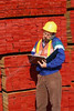 P3.1 / A warehouse worker or truck driver holding a clipboard with papers; somebody signing a paper on a clipboard. FOR RWC.<br /> <br /> Choice 5 of 11