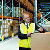 P3.1 / A warehouse worker or truck driver holding a clipboard with papers; somebody signing a paper on a clipboard. FOR RWC.<br /> <br /> Choice 6 of 11