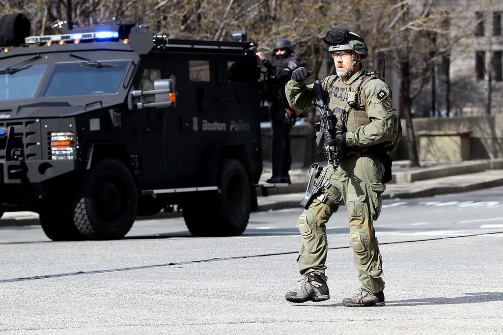 Boston, MA, April 15, 2013: <br /> A Boston SWAT team member walks near the perimeter of Copley Square after two explosions were detonated at the finish line of the 2013 Boston Marathon. <br /> (Photo by Billie Weiss)