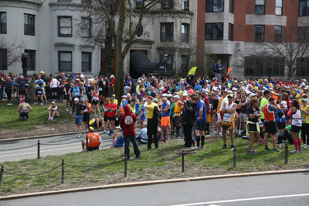 Boston, Mass. April 15- Runners were corralled by race officials and police officers at the 25 mile marker of the Boston Marathon.  The race was stopped due to explosions at the finish line.  Photo by Hannah Klarner/ Boston University News Service