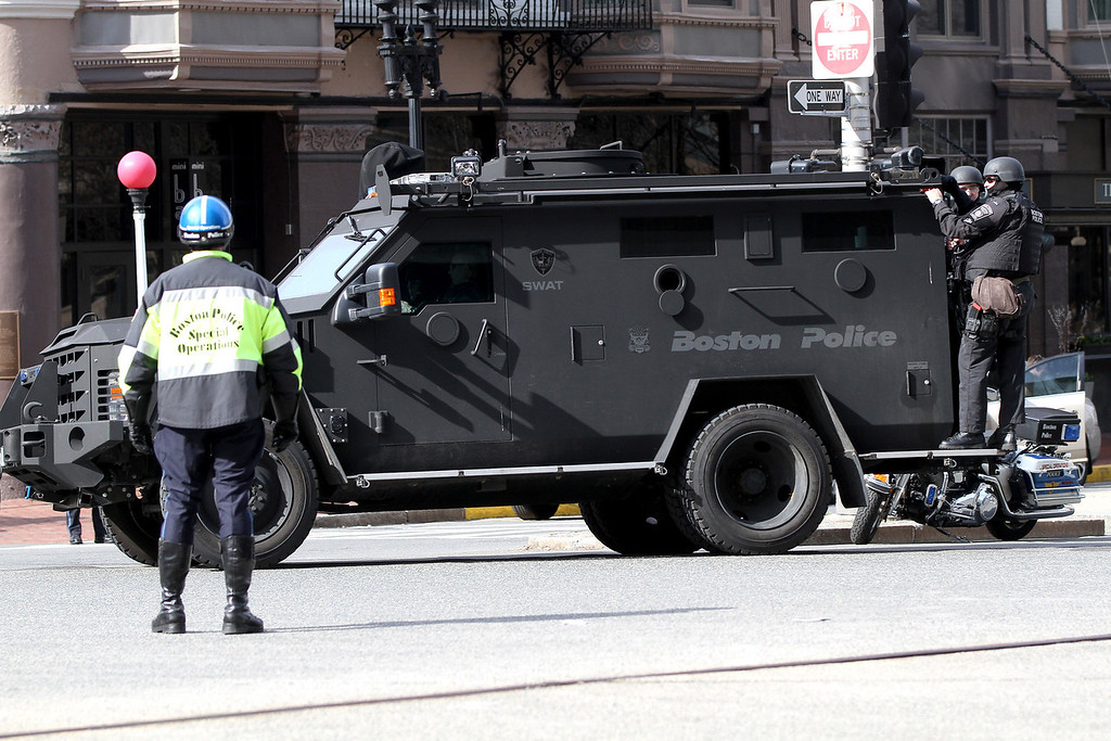 Boston, MA, April 15, 2013: <br /> Boston SWAT team members patrol near the perimeter of Copley Square after two explosions were detonated at the finish line of the 2013 Boston Marathon. <br /> (Photo by Billie Weiss)